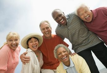 Group of older multicultural people laughing together